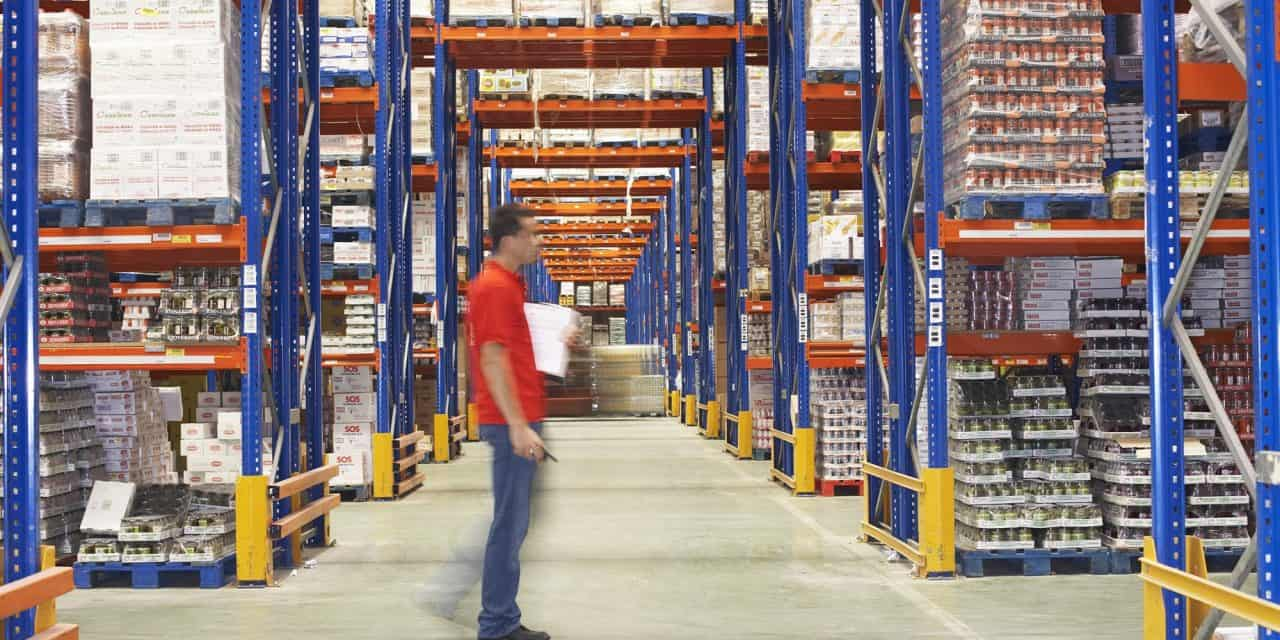 Man standing in Pallet Racking system