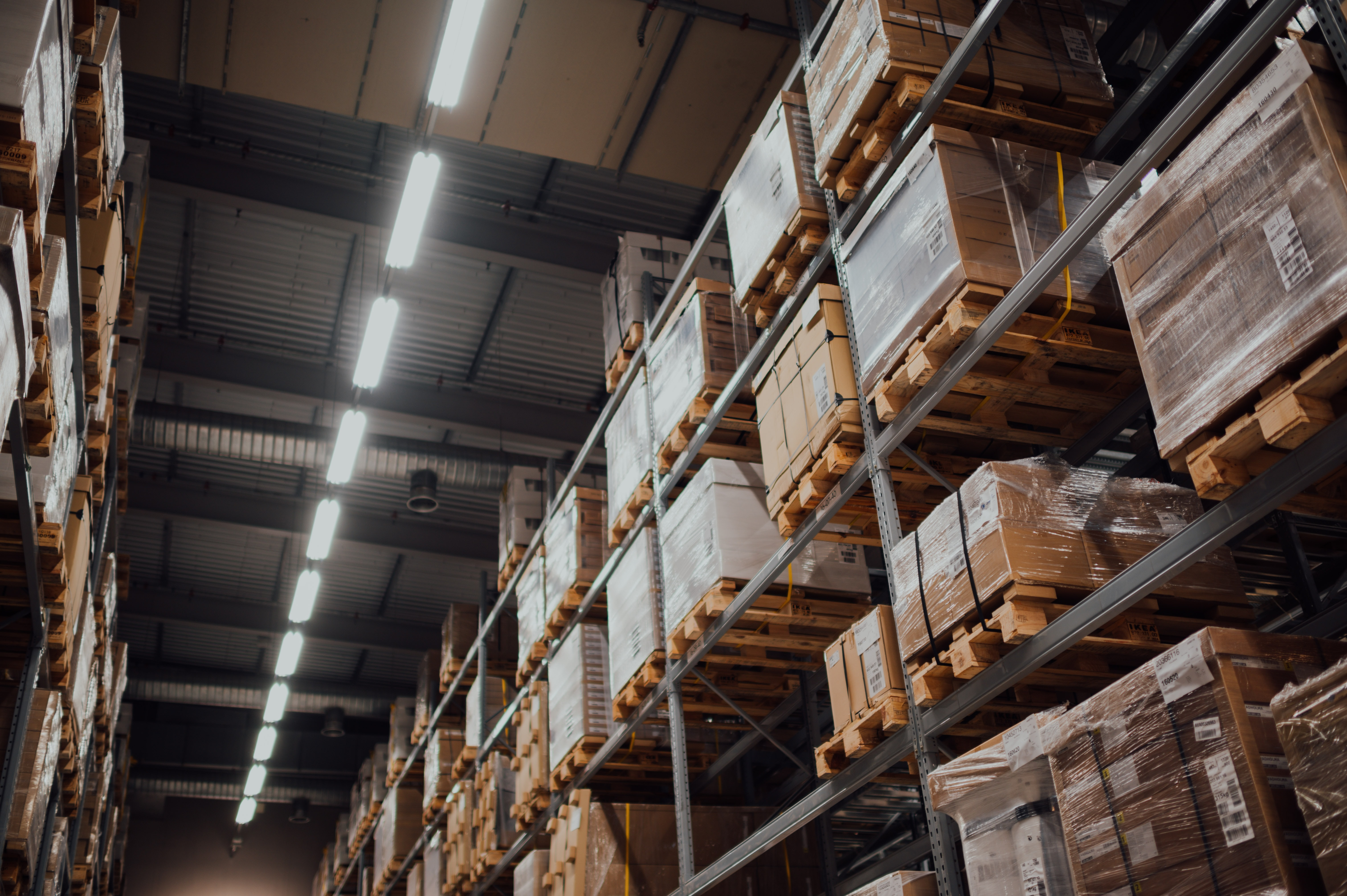 warehouse shelves stacked with pallets of supplies