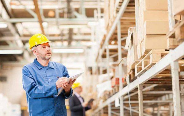 a man checking inventory at a warehouse