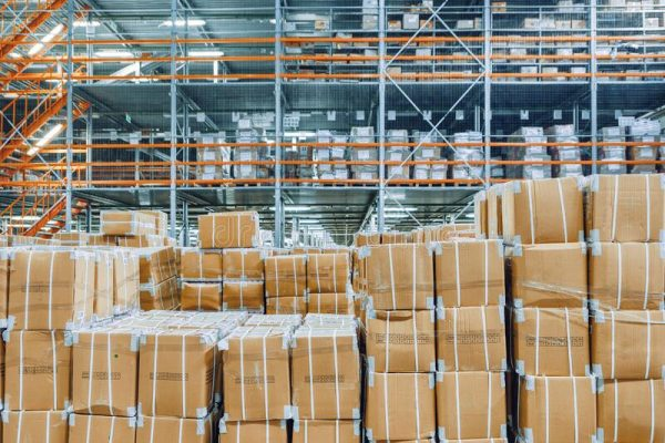 large boxes stacked inside a warehouse