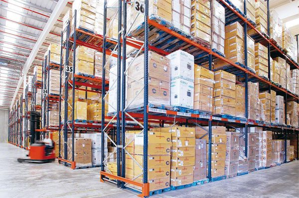 shipping boxes stored on tall pallet racks inside a warehouse