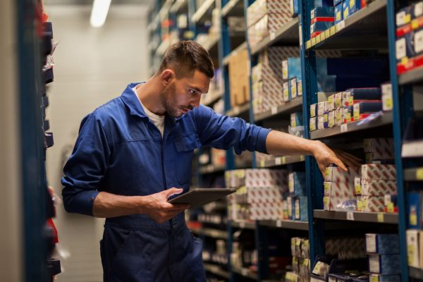 a man doing an inventory check in a warehouse