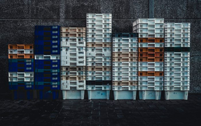 plastic storage containers stacked up against wall